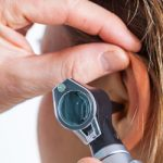 audiologist testing hearing