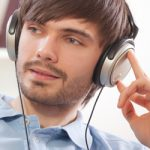 man enjoying hearing sound