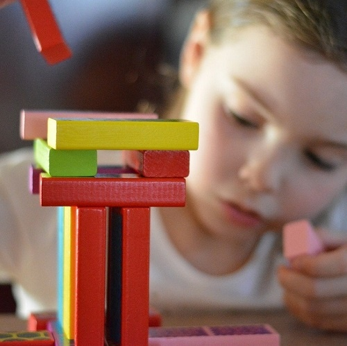 Child playing with blocks at THC Hobart