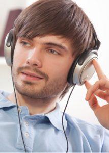 man enjoying hearing sound