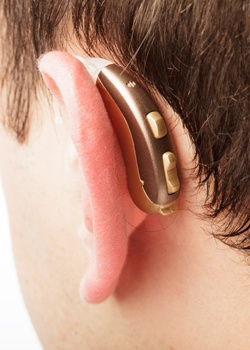 hearing aid in place behind ear