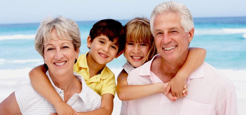 Happy grandparents and children on Hobart beach
